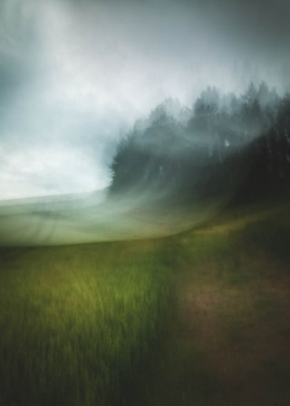 A sweeping abstract ICM showing a forest alongside fields